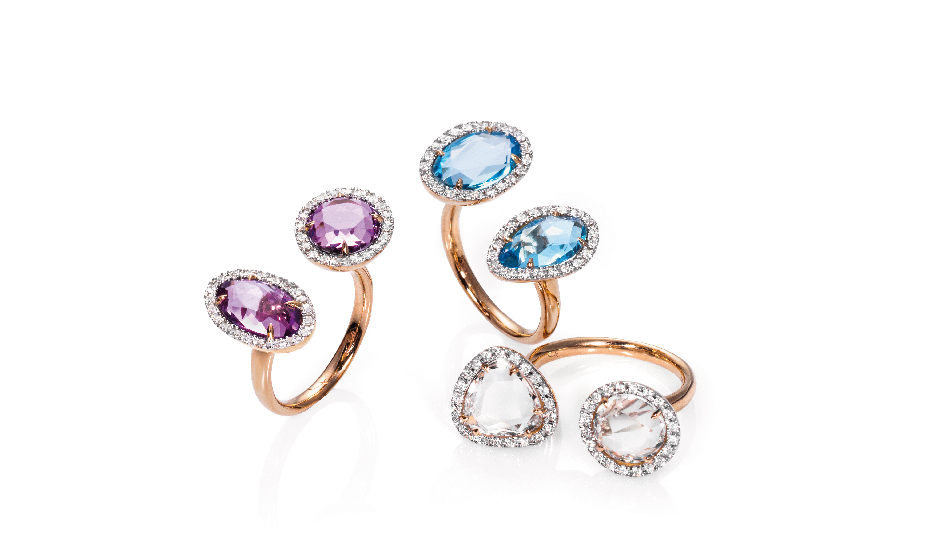 <p>18kt pink gold rings with&nbsp;amethyst, blue topaz, crystal rock and diamonds</p>