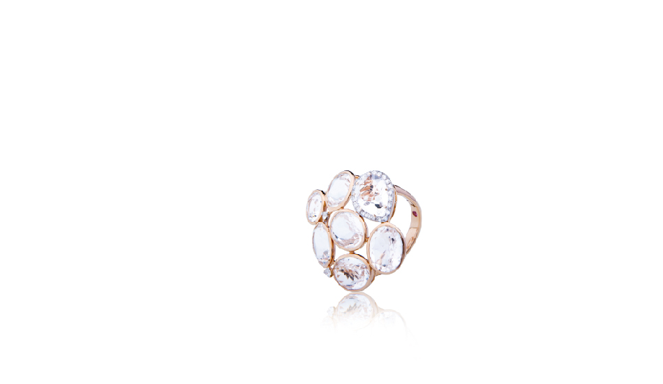<p>18kt pink gold ring with crystal rock and diamonds</p>