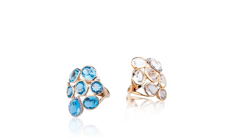 <p>18kt pink gold rings with blue topaz, crystal rock and diamonds</p>
