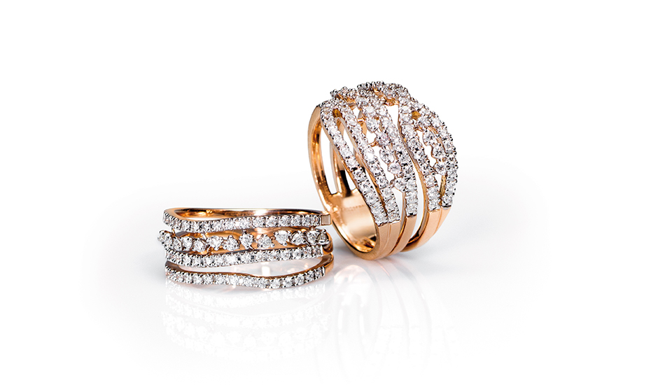<p>18kt pink gold rings with white diamonds</p>