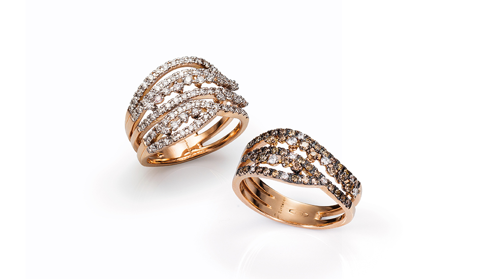 <p>18kt pink gold rings with white and brown diamonds</p>